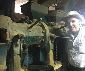 Edwardo of OVM Mill proudly shows the coffee milling machine on Ladro Roasting's Peru Coffee Buying trip 2017