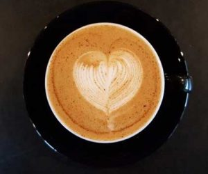 Survive Seattle's long gray winter with a perfectly brewed coffee from Caffe Ladro, pictured with heart shaped latte art.